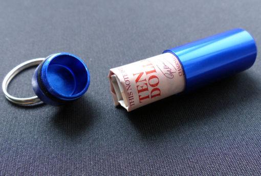 Waterproof capsule case emergency cash holder