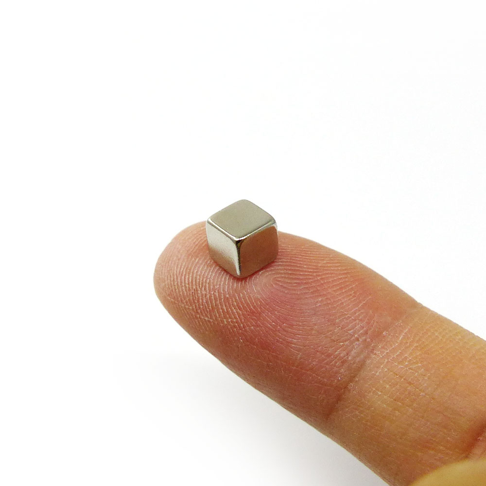cube neodymium magnets 5x5x5mm on fingertip