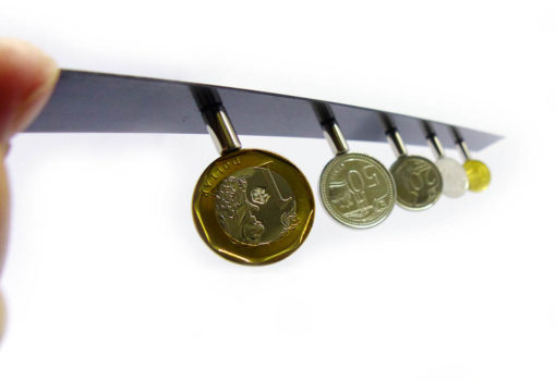 coins attached with magnets on steel strip